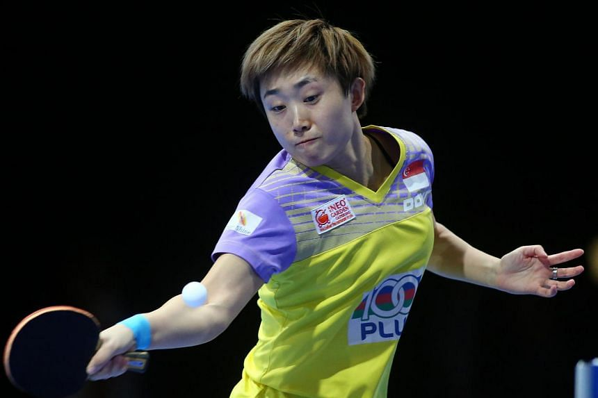 Feng Tianwei of Singapore returning the ball to Hirano Miu of Japan during their women's singles quarter final table tennis match in the ITTF Nakheel Table Tennis Asian Cup, on April 29, 2016.
