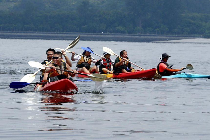 Families kayaking at OBS' Pulau Ubin camp.