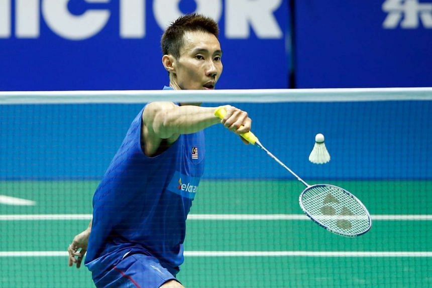 Lee Chong Wei of Malaysia hits a return against Chen Long of China during their men's singles final match at the 2016 Badminton Asia Championships in Wuhan, China on May 1, 2016.