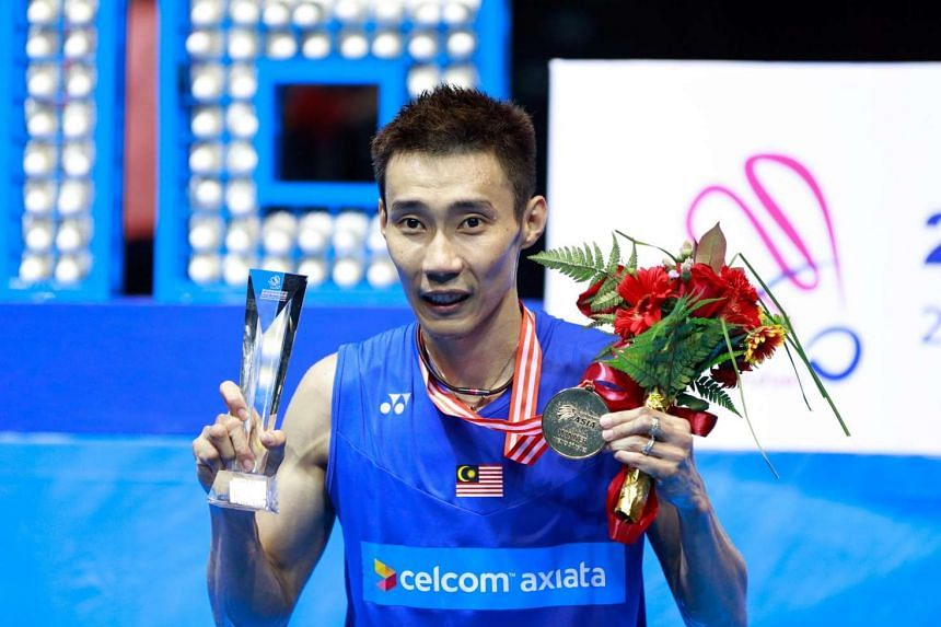 Lee Chong Wei of Malaysia poses with his gold medal after winning the men's singles final at the 2016 Badminton Asia Championships on May 1, 2016.
