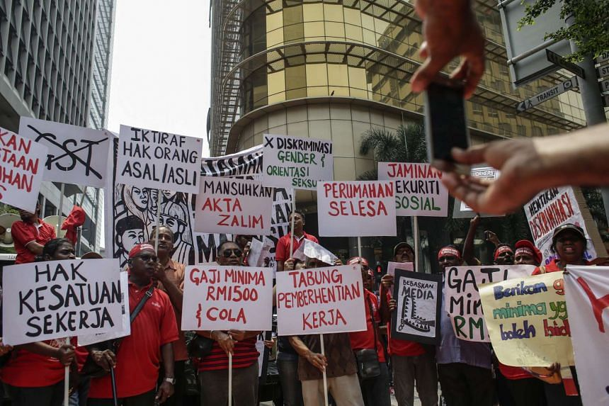 Protesters holding placards during a May Day rally in Kuala Lumpur, Malaysia on May 1, 2016.