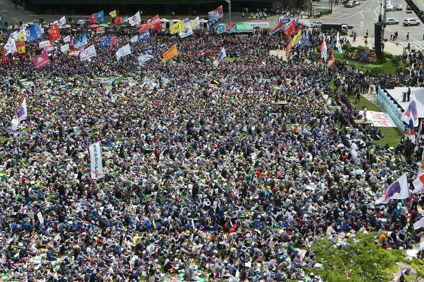 South Korean unionised workers participating in a May Day rally in front of the City Hall in Seoul on May 1, 2016.
