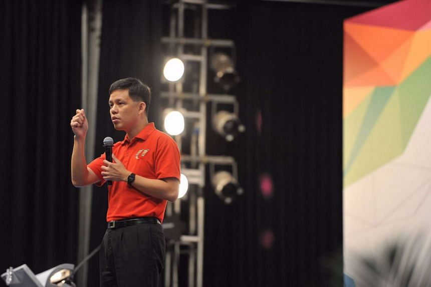 NTUC secretary-general Chan Chun Sing announces the tie-up between NTUC and NTU during the May Day Rally.