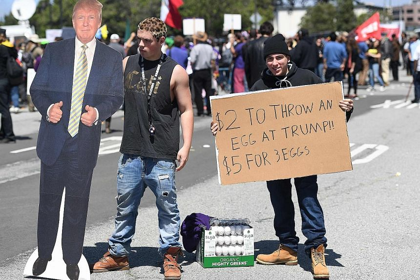 Protesters egging others on outside a hotel in California where Mr Trump was to speak last Friday, forcing the Republican front runner to duck in via a back entrance.