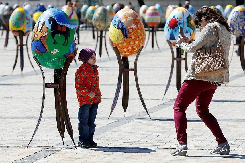 Ukrainian Easter eggs or Pysanka, which are made using a method similar to batik dyeing, installed as part of the upcoming celebrations in central Kiev, Ukraine. Many Christians celebrate Easter in March, based on the Gregorian calendar, but most Ort