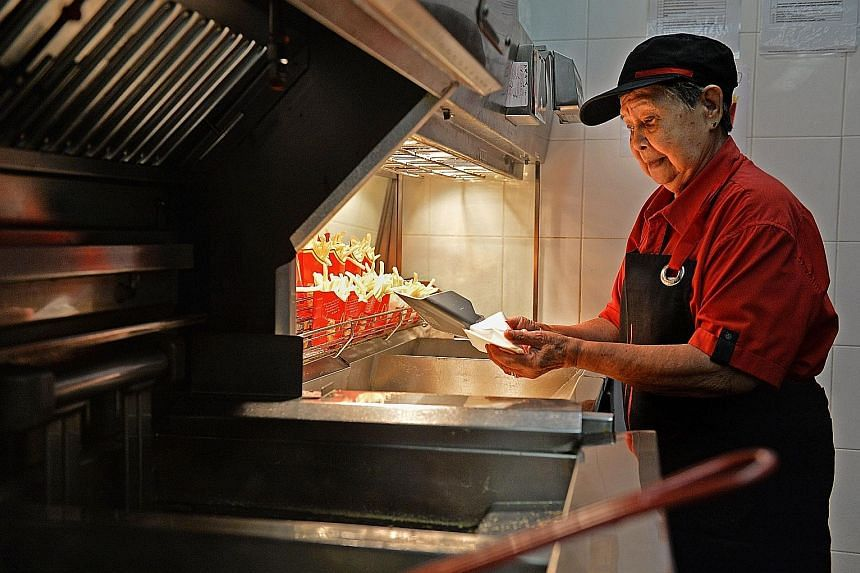 Madam Goh Gwek Eng finds cooking french fries the most challenging as it can get very hot near the fryer.