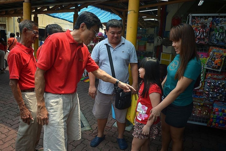 Dr Chee meeting residents at the foot of Block 154, Bukit Batok West Avenue 8, yesterday. He said he wanted to show that full-time MPs can take care of residents a lot better.
