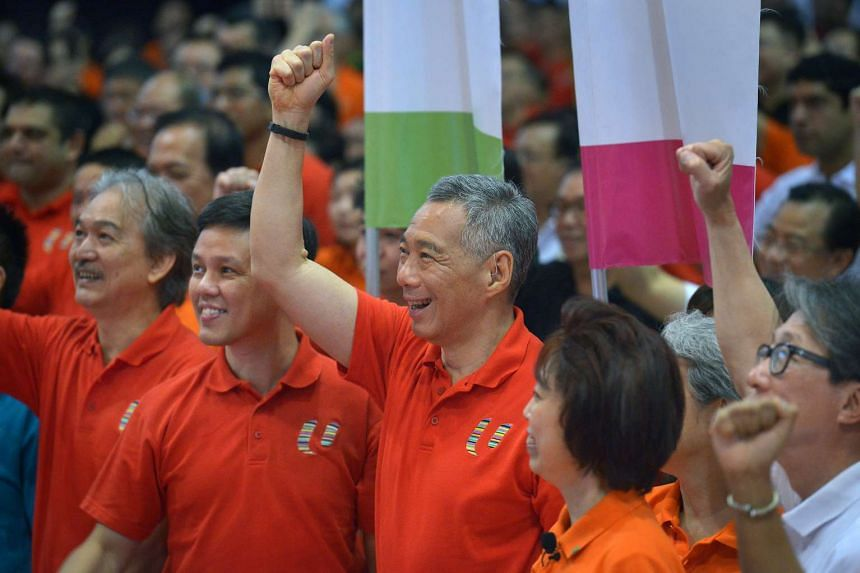 Prime Minister Lee Hsien Loong posing for a photo at the May Day rally.