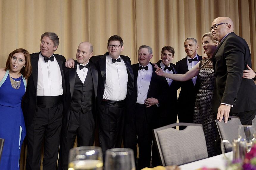 US President Barack Obama (third right) poses with members of the White House Correspondents' Association during their annual dinner at the Washington Hilton hotel.