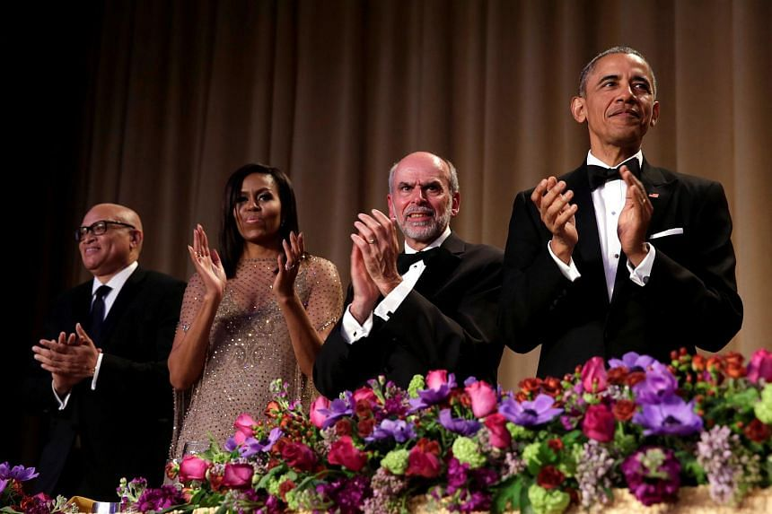 US President Barack Obama applauds during the White House Correspondents' Association annual dinner.