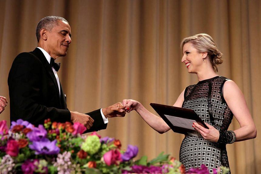US President Barack Obama greets White House Correspondents' Association (WHCA) President Carol Lee at the White House Correspondents' Association annual dinner.