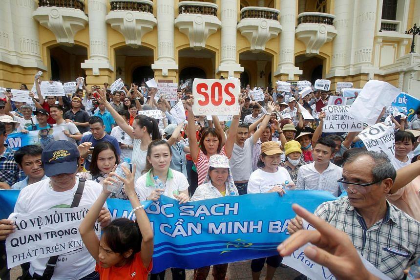 Demonstrators protest against Taiwanese enterprise Formosa Plastic, calling for cleaner waters in the central regions after the recent spate of mass fish deaths in Hanoi, Vietnam, on May 1, 2016.