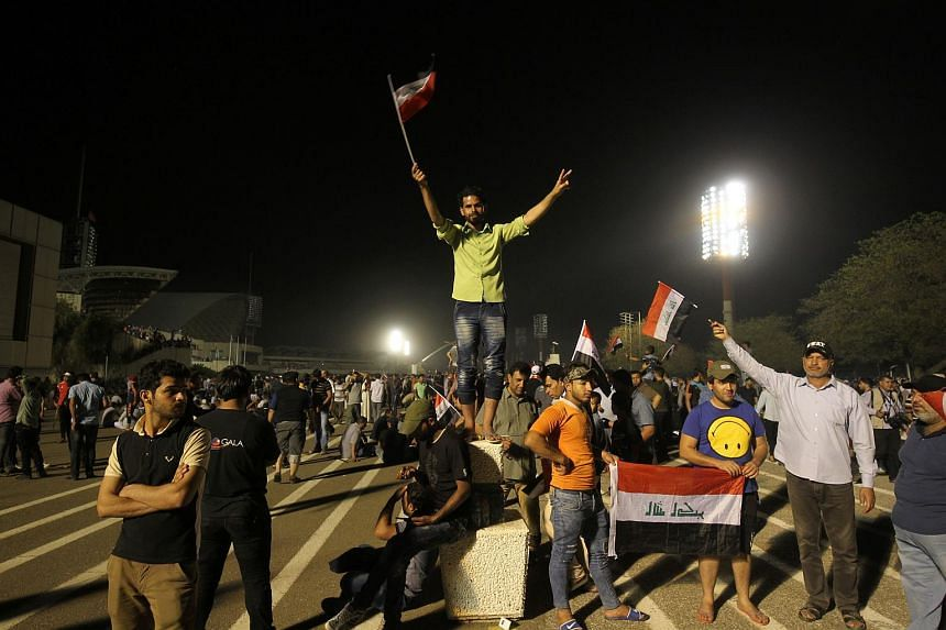 Supporters of cleric Moqtada al-Sadr celebrate after breaking into Baghdad's heavily fortified Green Zone, on April 30, 2016.