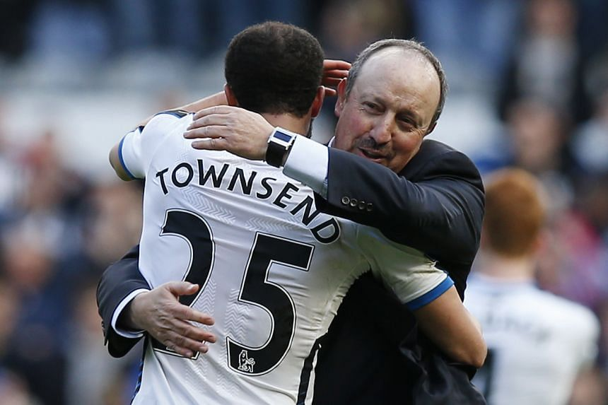 Newcastle manager Rafael Benitez celebrates with Andros Townsend at the end of the match.