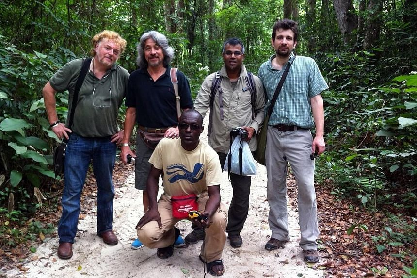 Mr Harrison (second from left), seen in this photo taken in Gabon in West Africa, often ropes in Mr Veera (second from right) to work with him on zoo projects in other countries.