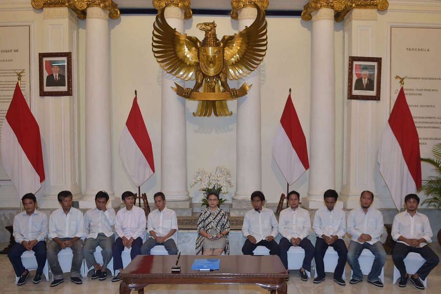 Indonesian Foreign Minister Retno Marsudi (centre) with the freed Indonesian sailors at the Foreign Ministry office in Jakarta on May 2, 2016.