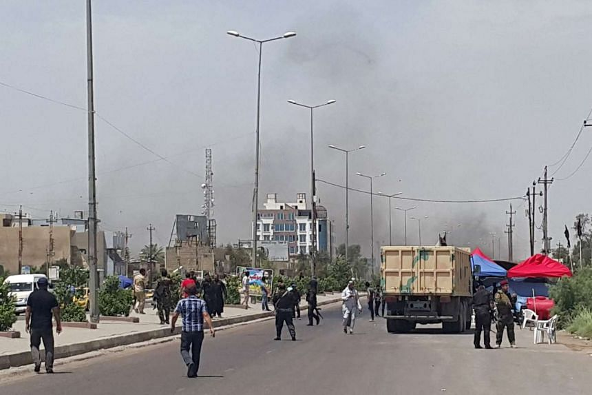 Smoke rises from a car bomb attack in the Saydiya district of southern Baghdad, on May 2, 2016.