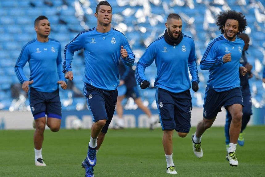 Cristiano Ronaldo (second from left) at a training session with his team mates at the Etihad Stadium in Manchester, on April 25, 2016.