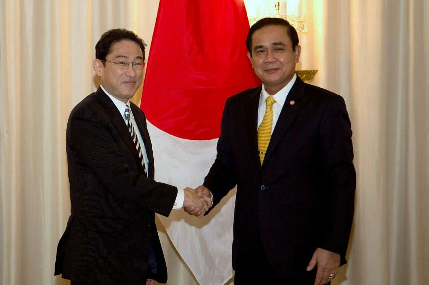 Thailand's Prime Minister Prayuth Chan-ocha (right) with Japan's Minister of Foreign Affairs Fumio Kishida at the Government House in Bangkok, on May 2, 2016.