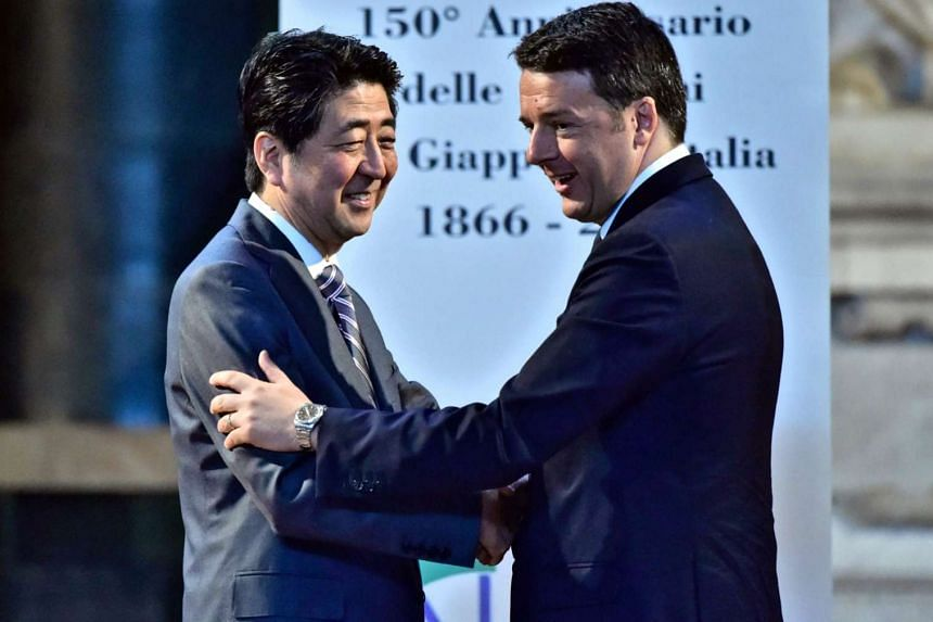 Italian Premier Matteo Renzi (right) welcomes Japanese Prime Minister Shinzo Abe for a bilateral meeting in Florence, Italy on May 2, 2016.