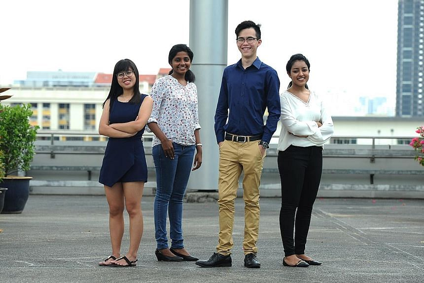 Among the poly grads studying at local universities are (from left) Ms Lena Tan, 20, and Ms Pavani Jeyathasan, 20, both at SMU; Mr Kenneth Gwee, 23, at NUS; and Ms Naseera Hidayahtullah, 21, at UniSIM.