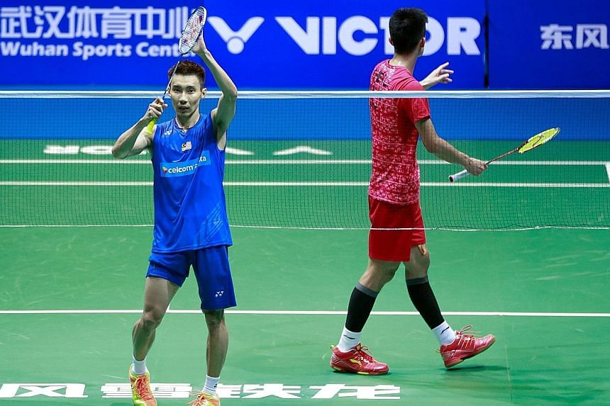 Malaysian star Lee Chong Wei (left) acknowledging the crowd in Wuhan after defeating home favourite Chen Long in the men's singles final at the Badminton Asia Championships in Wuhan yesterday. With that win, Lee has a 13-12 edge in career meetings wi