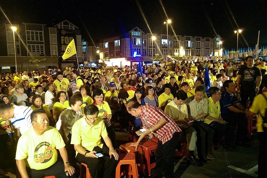 The crowd (above) at a rally featuring BN candidates in the Sarawak state elections. BN is hoping the popularity of Sarawak Chief Minister Adenan Satem will help the ruling coalition reclaim urban seats lost in the last state polls five years ago. Ma