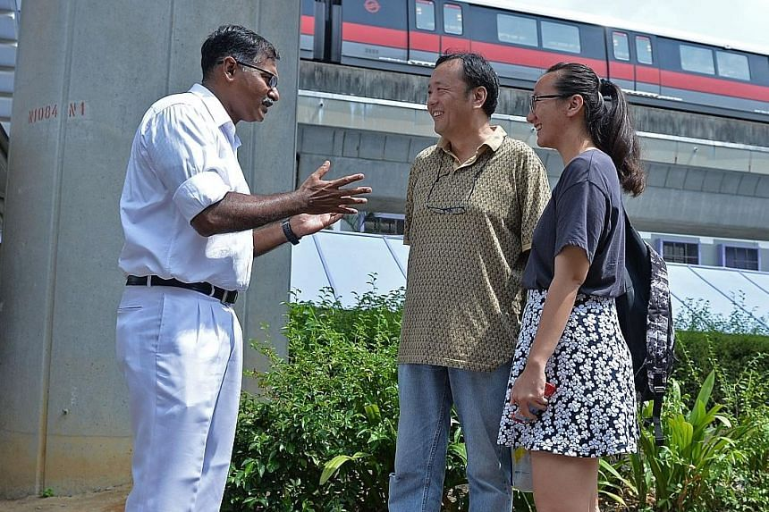 Mr Murali speaking with residents in the vicinity of Bukit Batok bus interchange yesterday. Dr Chee greeting a Bukit Batok resident yesterday. On his right is his wife Huang Chih Mei.