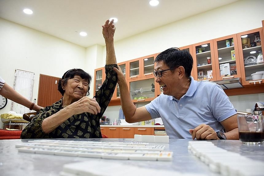 Mr Richard Chan, 67, attending the Alzheimer's Disease Association's Family of Wisdom programme with his mother, Madam Cheng Wee Boon, 89, who has dementia.