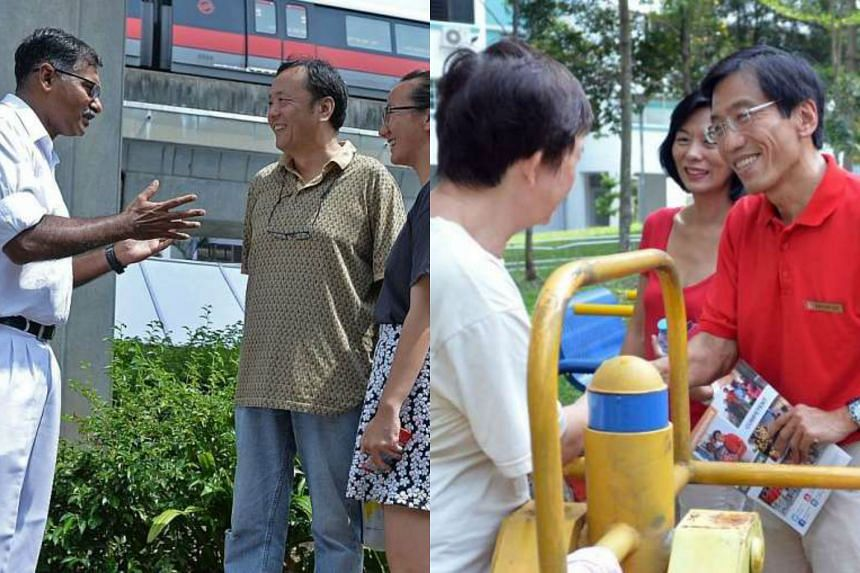 Mr Murali (left) and Dr Chee speaking with Bukit Batok residents yesterday.