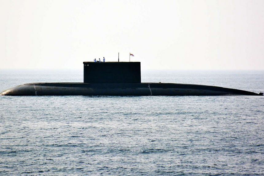 Indian Navy personnel standing on an Indian Navy submarine during the International Fleet Review in Visakhapatnam on Feb 6, 2016.