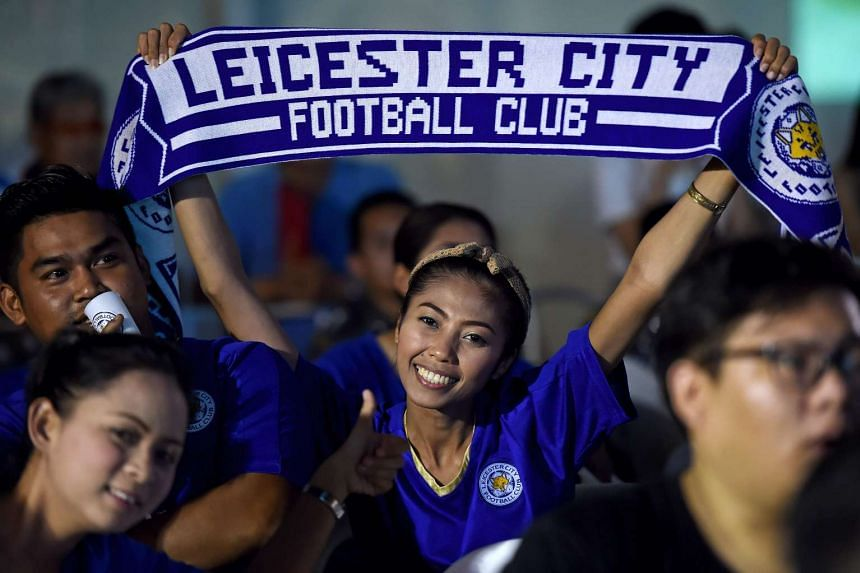 A Leicester City football supporter watches a live broadcast of the English Premier League football match between Manchester United and Leicester City in Bangkok, on May 1, 2016.