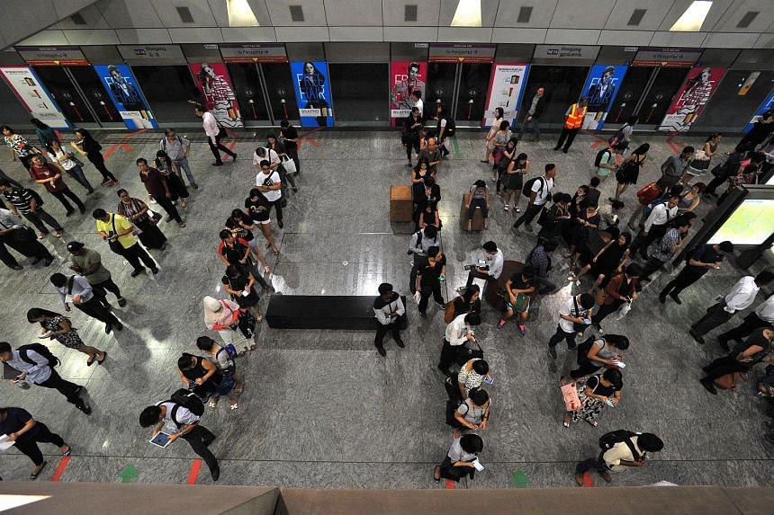Commuters at Hougang MRT station. Public transport infrastructure could be improved to reduce energy consumption.