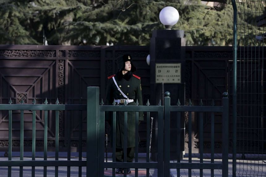 A paramilitary policeman standing guard in front of the North Korean embassy in Beijing, China, on Feb 7, 2016.
