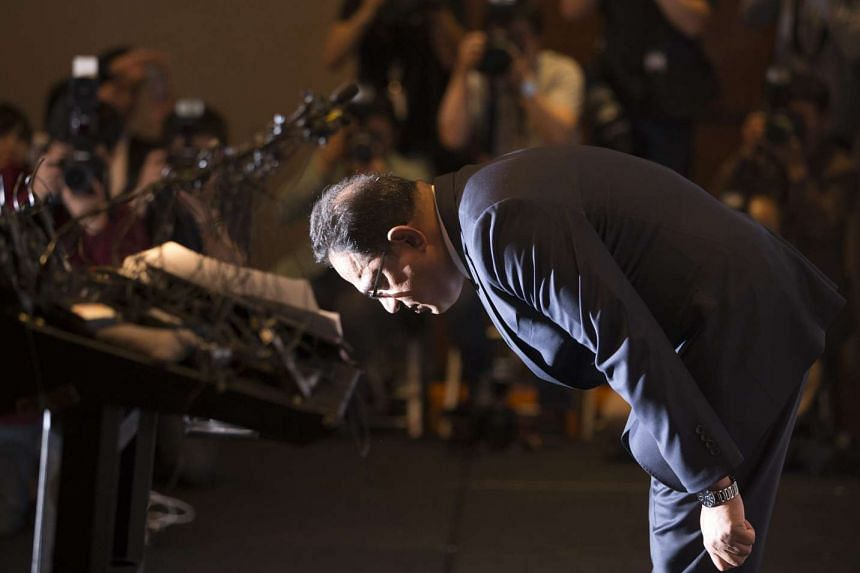 Head of Oxy Reckitt Benckiser Korea Atar Safdar bows deeply before a media conference at a hotel in Seoul, South Korea, on May 2, 2016.