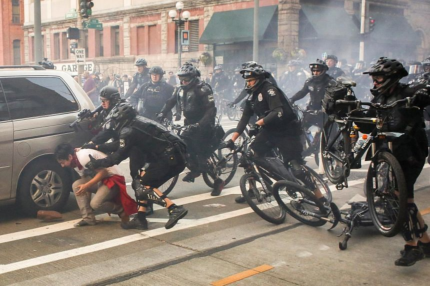 Police officers detaining a protester during anti-capitalist protests following May Day marches in Seattle, Washington, on May 1, 2016.