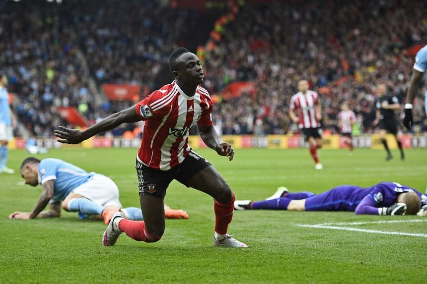 Sadio Mane celebrates after scoring the the fourth goal for Southampton and completing his hat trick.
