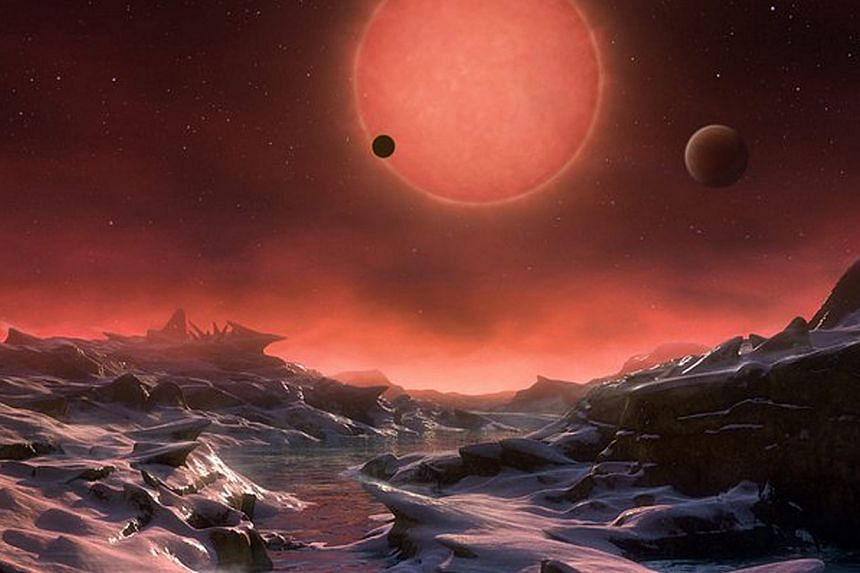 An artist's impression provided by the European Southern Observatory (EOS) on Monday (May 2) shows an imagined view of one of the three planets orbiting that could sustain life.
