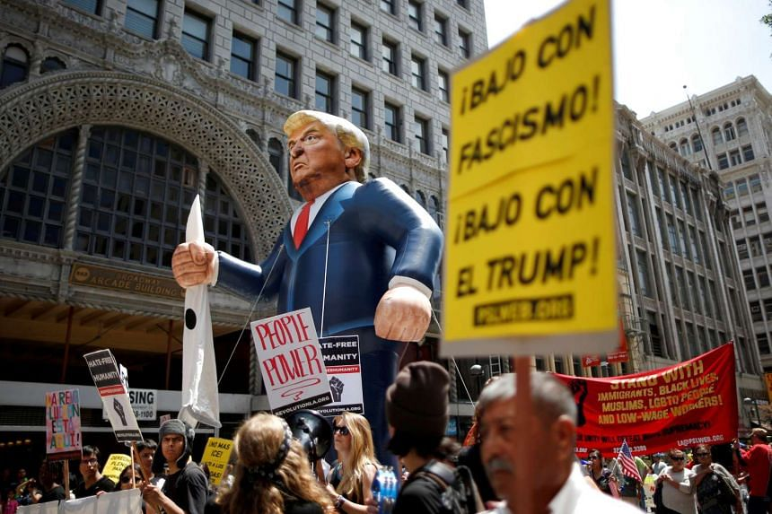 Protesters hold an effigy of Republican presidential hopeful Donald Trump during a May Day rally in Los Angeles, on May 1, 2016.