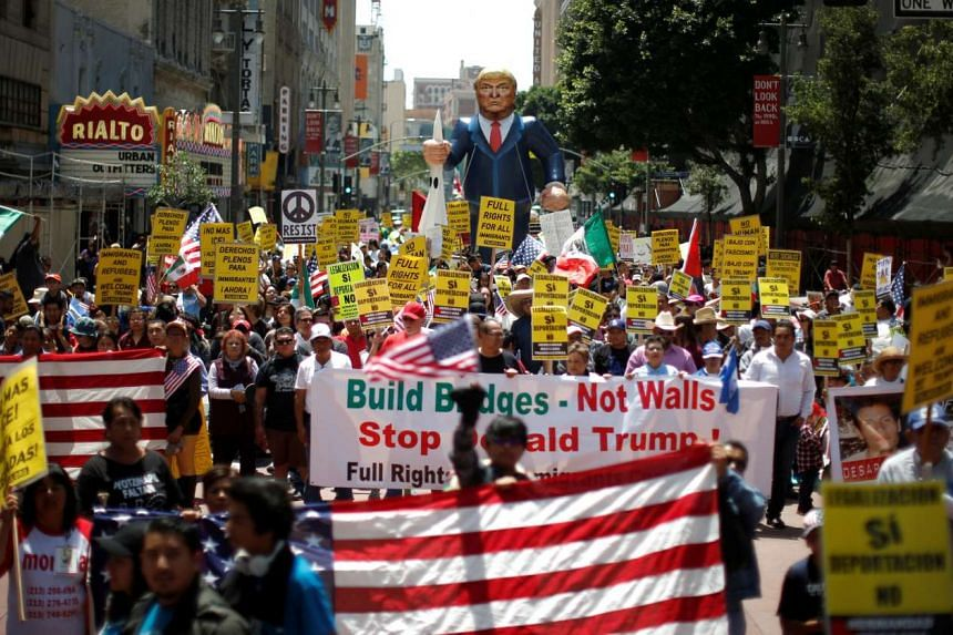 People march with an inflatable effigy of Republican presidential candidate Donald Trump during a May Day rally in Los Angeles, on May 1, 2016.