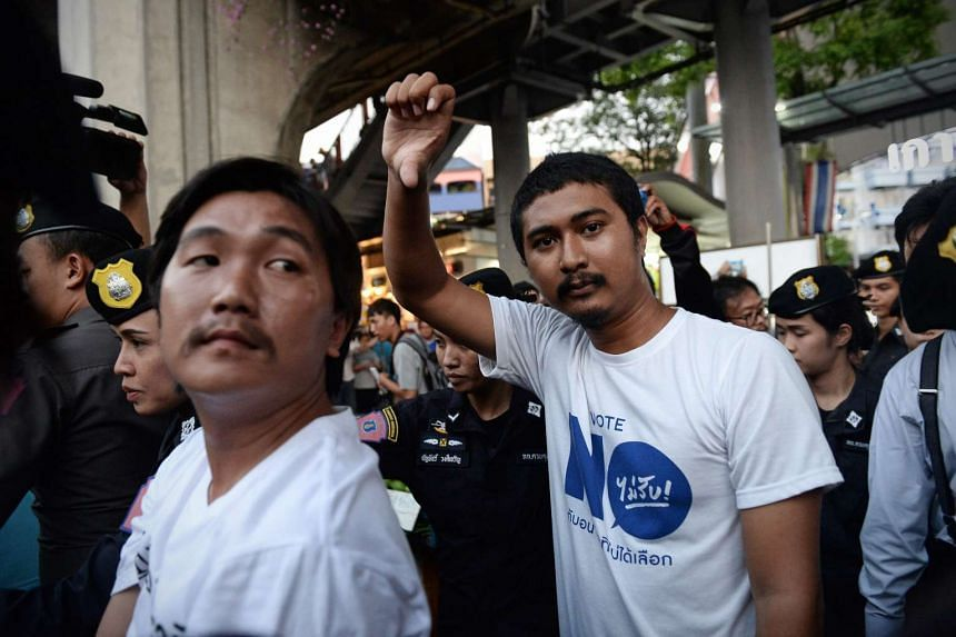 Activists are detained by police for defying the ban on public gatherings, and for protesting against the recent arrest of critics of the military regime in Bangkok, on April 27, 2016.