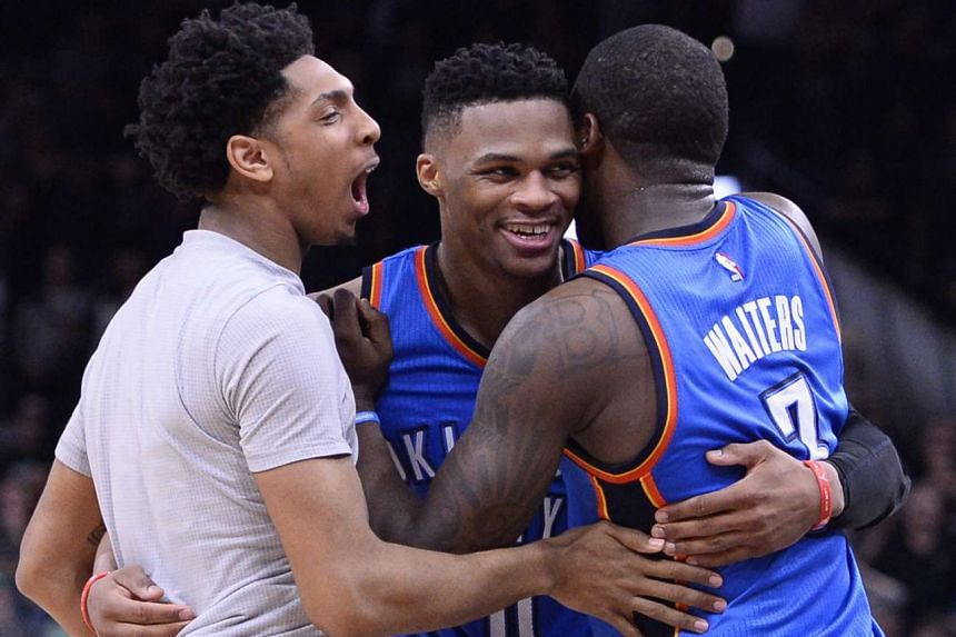 Oklahoma City Thunder's Russell Westbrook (centre) celebrates with his team mates during the Western Conference semi-finals against the San Antonio Spurs, on May 2, 2016.