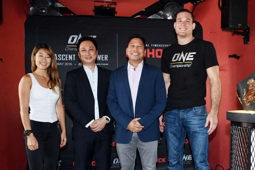 (From left) Angela Lee, Bernard Teng, country sales manager of Casio Singapore, Victor Cui and Roger Gracie at One FC pre-fight press conference.