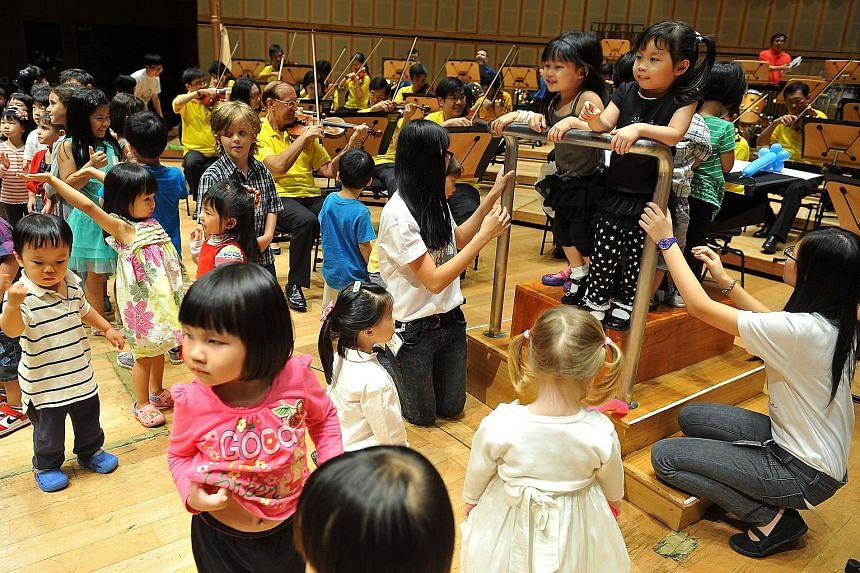 Children attending the Babies' Prom get to share the stage with the musicians towards the end of the concert.