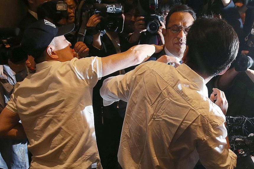It was chaos at one point as some victims' relatives surrounded Mr Safdar during a press conference in Seoul yesterday at which he apologised for his firm's role in selling a humidifier disinfectant blamed for more than 100 deaths in South Korea.