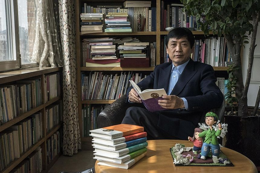 Author Cao Wenxuan at his home in Beijing. In the foreground are figurines of his novels' characters.