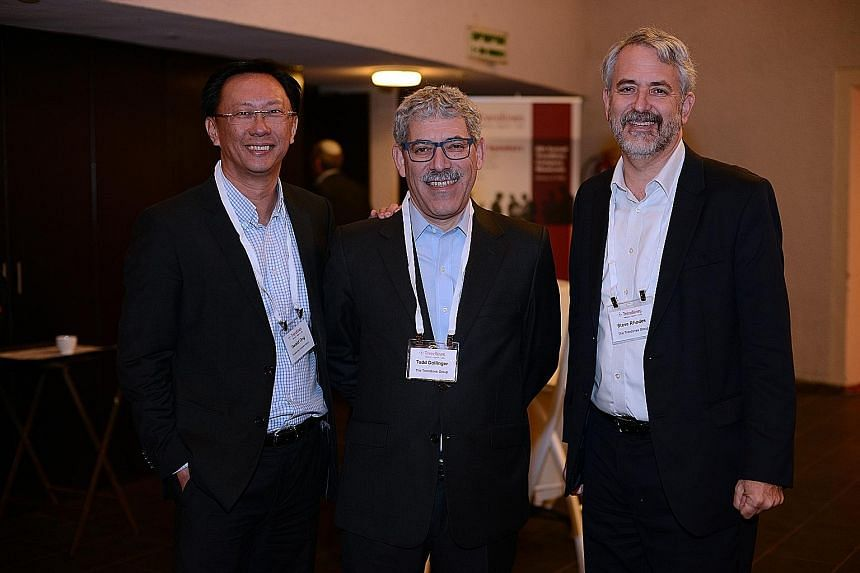 Attending a Trendlines event in Israel earlier this year were (from left) Mr Gerald Goh, chief executive of PrimePartners Corporate Finance, and Mr Dollinger and Mr Rhodes, Trendlines' co-founders.