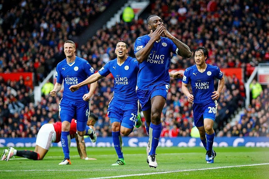 Leicester City's Wes Morgan (foreground) blows kisses to the fans after scoring the equaliser in the Premier League match against Manchester United at Old Trafford on Sunday.