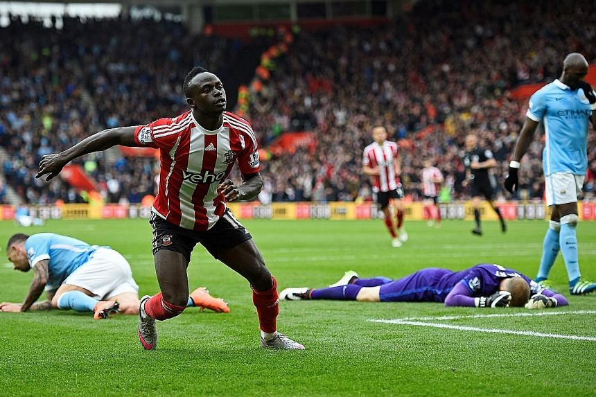 Southampton forward Sadio Mane (foreground) celebrates after scoring the Saints' fourth goal and completing his hat-trick. Sunday marked the first time City conceded four goals in the league since November.