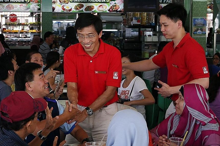 Dr Chee greeting people in Bukit Batok during a walkabout yesterday. Speaking to reporters after an event in the constituency, he reiterated his view that it is impossible for an MP to hold a full-time job and still discharge his responsibilities ful